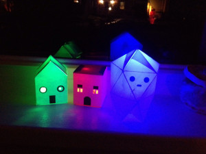 Miniature haunted houses and ghost.  Simple structures lit with LEDs and coin cell batteries.