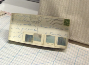 interior writing, postage stamp, and post mark, with corners that were trimmed away